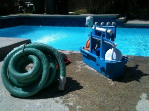 pool cleaning equipment next to swimming pool