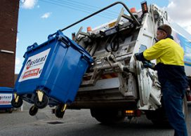 Skip bin being unloaded into a truck