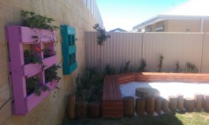 Recycled Waste Reusing Pallets As Wall Planter Boxes