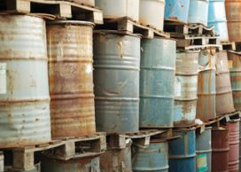 rusty 44 gallon drums on pallets